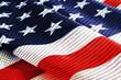 Leinwandbild Motiv Binary code with red inscription hacker usa on background of American flag.