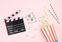 Movie Clapperboard, Tickets And Popcorn Over Pink Background. Movie Night, Home Cinema, Party Invitation