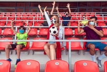 Fans Watching Football Match Under Social Distancing Measures