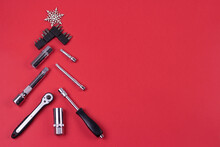 Creative Christmas Tree On Red Background, Made Of Wrenches.Set Of Tools Supplies For Repair Car On Xmas Backdrop. Industrial Greeting Card And Christmas Happy New Year Concept.