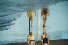 People Walking In The Beach