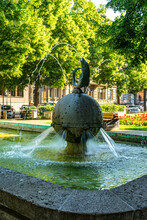Vertical Shot Of A Fish Fountain In A Fischtor Square Of Mainz, Germany