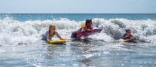 Children Surfing Ocean Waves At Myrtle Beach