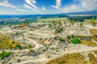 Aerial panorama of the ruins of the ancient city of Tel Megiddo, archaeological park, site of the biblical Armageddon in Israel with cloudy sky