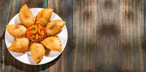 Traditional baked Argentinian empanadas savoury pastries with meat beef stuffing Fototapet