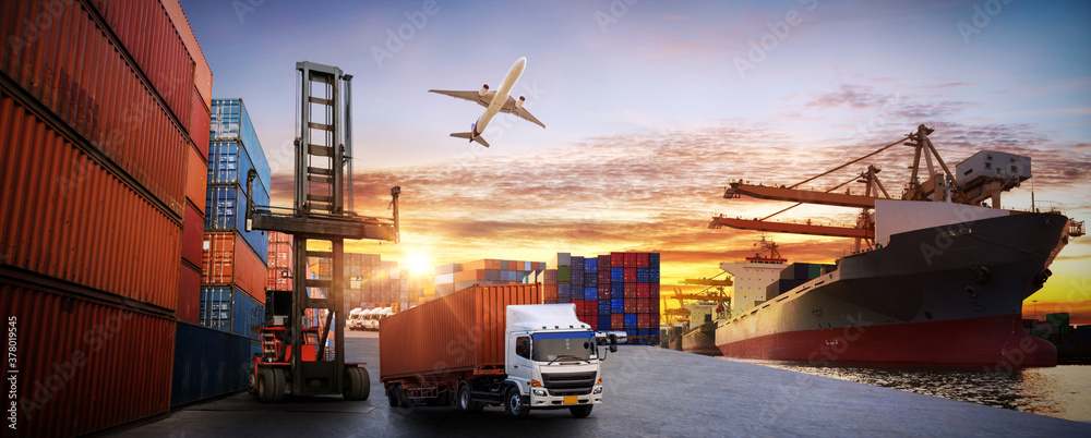 Fototapeta Logistics and transportaIndustrial Container Cargo freight ship, forklift handling container box loading for logistic import export and transport industry concept backgroundtransport industry
