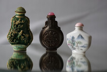 Closeup Of Ornamented Iron And Porcelain Snuff Bottles