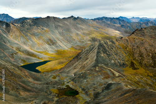 Fototapety, obrazy: Grizzly Lake campsite surrounded by mountains in Tombstone Territorial Park, Yukon, Canada