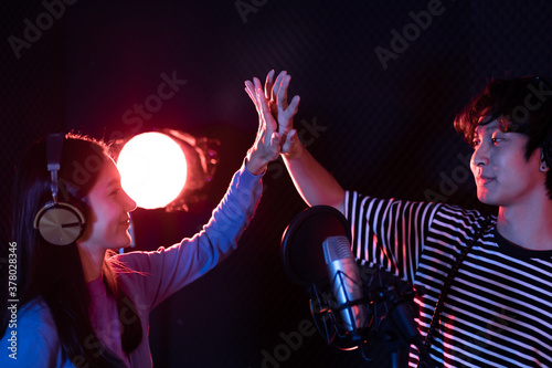 Young asian attractive musicians happy singing together recording new song Wallpaper Mural