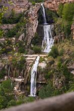 One Of Waterfalls Near Sant Miquel Del Fai Monastery In Catalan Pre-coastal Mountain Range, Spain.