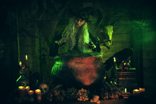 Witch Cooks Dinner In His Lair