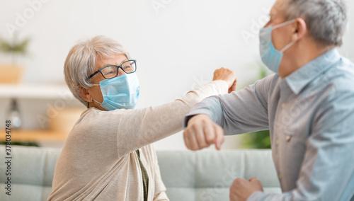 Fototapeta Senior couple greeting bumping elbows obraz