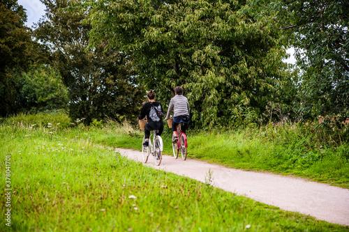 Fototapeta Cyclists Cycling on Bicycles The Greenway Cycle and Walking Track Nr. Stratford upon Avon Warwickshire English Midlands England UK. obraz
