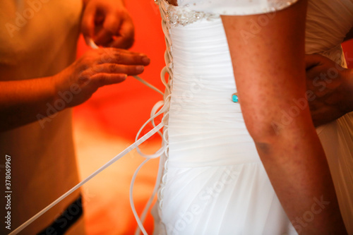 dressing the bride, lacing the bodice dress Canvas Print