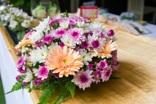 Wedding Bouquet Of Purple And White Flowers Lying On Wooden Floor