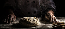 Chef Hands Cooking Dough On Dark Wooden Background. White Flour Flying Into Air. Food Concept
