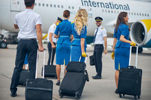 Airline Workers Walking Down T...