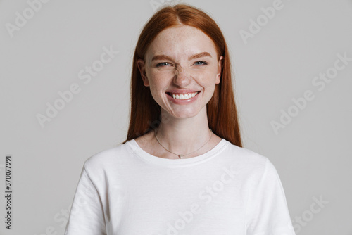 Image of happy ginger girl smiling and grimacing at camera