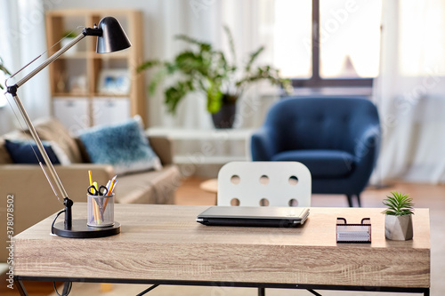 Obraz interior, remote job and business concept - laptop, lamp and stationery on table at home office - fototapety do salonu