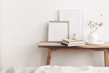 Portrait And Square Wooden Picture Frames Mockups. Vintage Bench, Table With Modern Ceramic Vase, Bunny Tail Dry Grass, Books And Cup Of Coffee. White Wall Background. Scandinavian Interior.