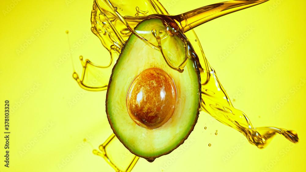 Leinwandbild Motiv - Lukas Gojda : Fresh cut avocado with oil stream. Concept of healthy fruit also useful in cosmetics.