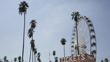Empty Ferris Wheel Spins, Classic Vintage Tickets Counter, Palm Trees, Slow Motion Low Angle