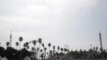 Fair Rides Before Opening, Ferris Wheel, Palm Trees, Cloudy Gloomy Sky