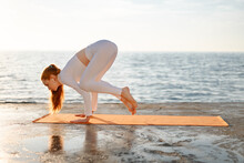 Image Of Sportswoman Doing Yoga Exercise While Working Out On Promenade
