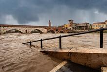 Verona, Ponte Pietra (Stone Bridge), I Century B.C, And Adige River In Flood After Several Violent Storms. UNESCO World Heritage Site, Veneto, Italy, Europe