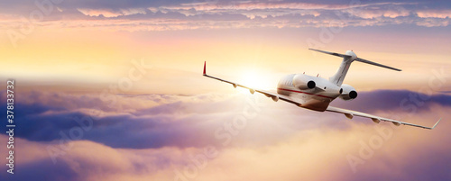 Fotografie, Obraz Private jetplane flying above clouds.