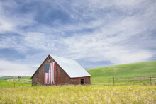 Original Photograph Of An Old Red Barn With An American Flag Hung From The Front