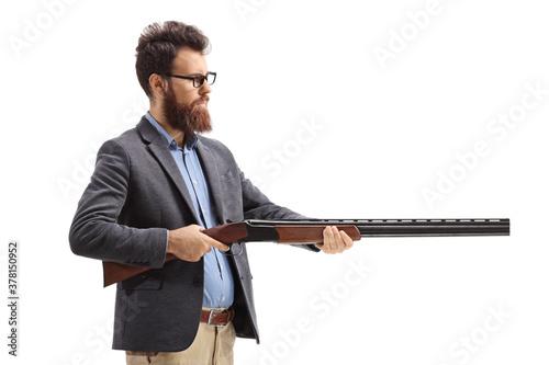 Obraz na plátne Bearded man aiming with a shotgun
