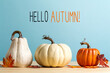 Leinwandbild Motiv Hello autumn message with pumpkins on a blue background