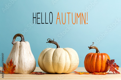 Hello autumn message with pumpkins on a blue background - 378164307