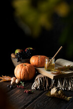 Dark Mood Still Life Autumn Composition. Autumn Harvest Of Vegetables, Fruits And Honey On A Wooden Table. Traditional Seasonal Food