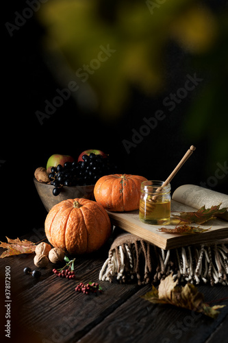 Fototapeta Dark mood still life autumn composition. Autumn harvest of vegetables, fruits and honey on a wooden table. Traditional seasonal food obraz
