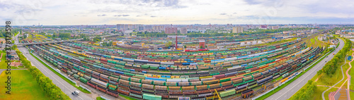 Fototapeta Panoramic aerial view of the city railway marshalling yard with many freight wagons with various cargoes