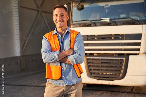 Obraz Driver standing near his truck - fototapety do salonu