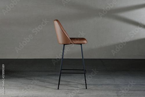 Obraz na płótnie Closeup of an armless chair with a concave back, loft-style furniture