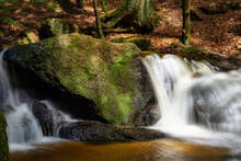 Beautiful Green Forest Landscape With Creek And Waterfall With Slow Shutter Speed And Bright Sunlight In The Summer. Tropical Nature Background