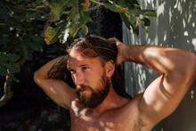 A Portrait Of An Attractive Man Having A Shower Outdoors