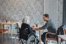 Man Visiting Grandmother At Th...