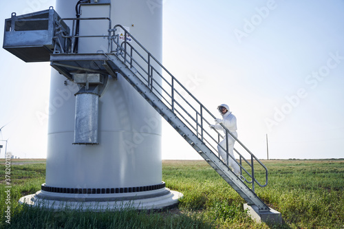 Astronaut in space suit climbing the rocket stairs Canvas