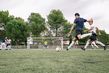 Soccer Player Kicking A Ball D...