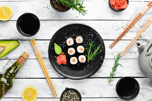 Fototapeta Sushi maki with salmon. Pieces of delicious sushi. Japanese cuisine obraz