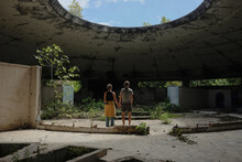 Young Couple In Abandoned Building