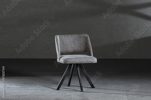 Fotografia Modern gray chair with a concave back and soft upholstery