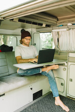 Young Man Working Remote From His Van