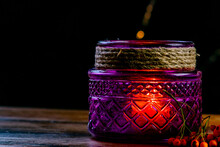 Purple Lantern, Orange Golden Nugget Pumpkin Rowan Berries And Two Candles On Wooden Rustic Table And Black Background With Yellow Bokeh Dots, Autumnal Warm Mood In Cozy Home Decoration.