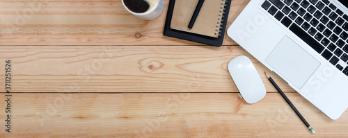 Fototapeta Top view of blank screen smart phone on wooden office desk with coffee cup, keyboard, supplies and copy space. obraz